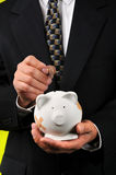 Businessman with piggy bank Royalty Free Stock Photos