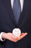 Businessman with piggy bank. Stock Images