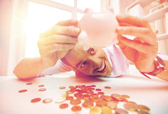 Businessman with piggy bank and coins at office Stock Image