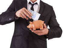 Businessman with piggy bank Royalty Free Stock Images