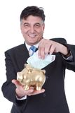 Businessman with piggy bank and money royalty free stock image