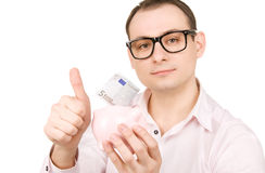 Businessman with piggy bank and money Stock Photography