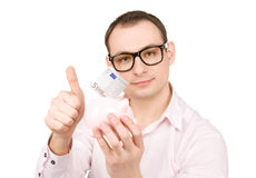 Businessman with piggy bank and money Royalty Free Stock Photos