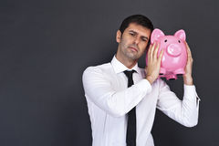 Businessman with a piggy bank Stock Photos