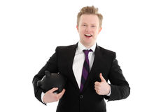 Businessman with piggy bank Stock Photos