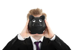 Businessman with piggy bank Stock Photography