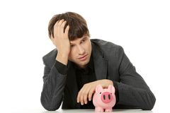 Businessman with piggybank Royalty Free Stock Photos
