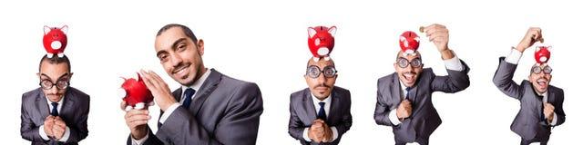 The businessman with piggybank on white Stock Photo