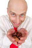Businessman with pile of coins Stock Photos