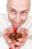 Businessman with pile of coins. Portrait of smiling bald headed businessman with pile of change in hands, isolated on white background stock photography