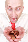 Businessman with pile of coins. Portrait of shocked young businessman with pile of coins or money, isolated on white background royalty free stock images