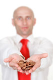 Businessman with pile of coins. Half body portrait of businessman with pile of coins in cupped hands, focus on foreground stock photos