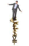 Businessman on a pile of currency symbols Royalty Free Stock Photography