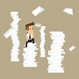 Businessman on a pile of paper paper Royalty Free Stock Photos