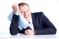 Businessman with pillow Stock Images