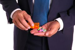 Businessman and Pills Stock Photography
