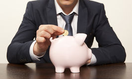 Businessman with pink piggy bank Royalty Free Stock Images