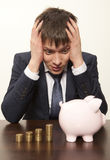 Businessman with pink piggy bank Stock Image