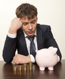 Businessman with pink piggy bank Stock Photos