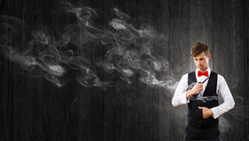 Businessman and pipe smoke Royalty Free Stock Image