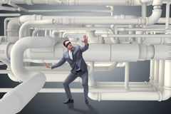 The businessman and piping at the plan Stock Photo