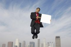 Businessman With Placard Royalty Free Stock Images
