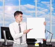 Businessman with placard Stock Photo