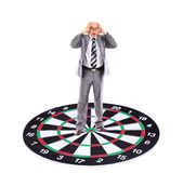 Businessman  placed on a dartboard Royalty Free Stock Images