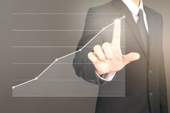 Businessman plan graph growth and increase of chart positive ind. Icators in his business Royalty Free Stock Photo