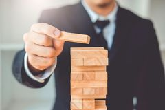 Businessman plan and strategy in business Domino Effect Leadership Management Solution concept.  royalty free stock image