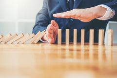 Businessman plan and strategy in business Domino Effect Leadersh stock images
