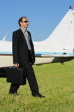 Businessman, plane Royalty Free Stock Photo