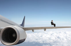 Businessman on a plane Royalty Free Stock Photography