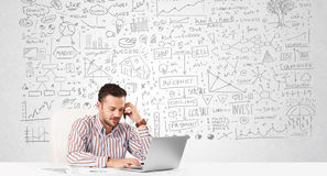 Businessman planning and calculating with various business ideas Stock Photo