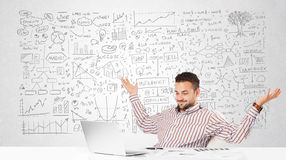 Businessman planning and calculating with various business ideas Royalty Free Stock Photo