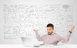 Businessman planning and calculating with various business ideas Royalty Free Stock Photos