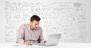 Businessman planning and calculating with various business ideas Royalty Free Stock Images
