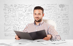 Businessman planning and calculating with various business ideas stock photos