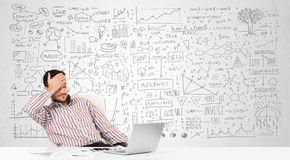 Businessman planning and calculating Stock Photo