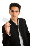 Businessman with plastic card. Royalty Free Stock Images