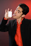 Businessman with plastic card. Humor. Stock Photography