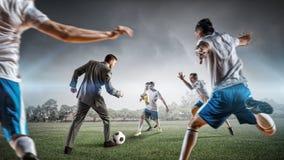 Businessman play ball . Mixed media Royalty Free Stock Image