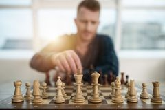 Businessman play with chess game. concept of business strategy and tactic stock photos