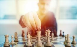 Businessman play with chess game. concept of business strategy and tactic