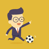 Businessman play football Stock Photos