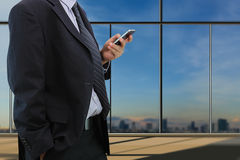 Businessman play smart phone Royalty Free Stock Photography