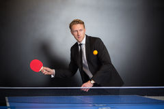 Businessman play tennis Stock Image