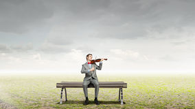 Businessman play violin Royalty Free Stock Photo