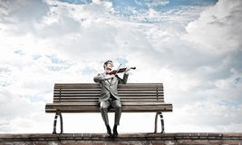Businessman play violin Stock Photography