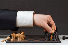 Businessman playing against the rules Stock Photo